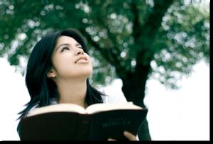 Dark haired girl reading Bible
